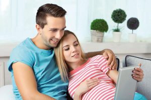 consumer leaflets couple on tablet