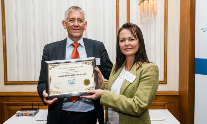 GGF CEO Kevin Buckley presents Katie Thornton of The Window Company (Contracts) Ltd with GLASS Charter Gold Level Certificate