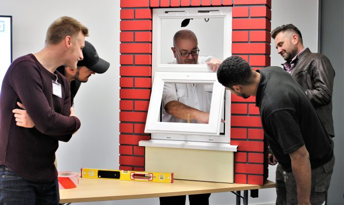 GGF Installer Training Course attendees examine a window installation